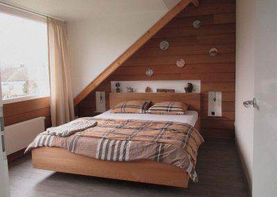 Slaapkamer van red cedar hout